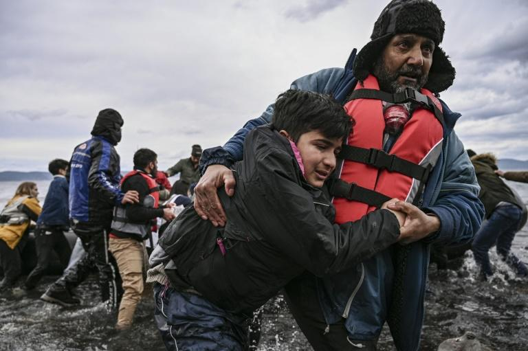 A dinghy with 54 Afghan refugees landed on the Greek island of Lesbos on February 28 (AFP Photo/ARIS MESSINIS)