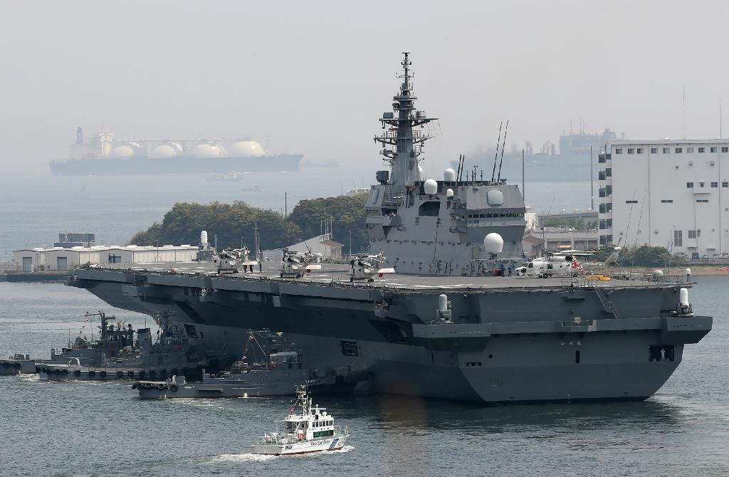 "Japan's new five-year defence plan calls for the military to upgrade two existing ""helicopter carriers"" so that they will also be able to launch fighter jets (AFP Photo/STR)"