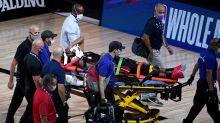 Heat F Derrick Jones Jr. exits game on stretcher after running into hard screen