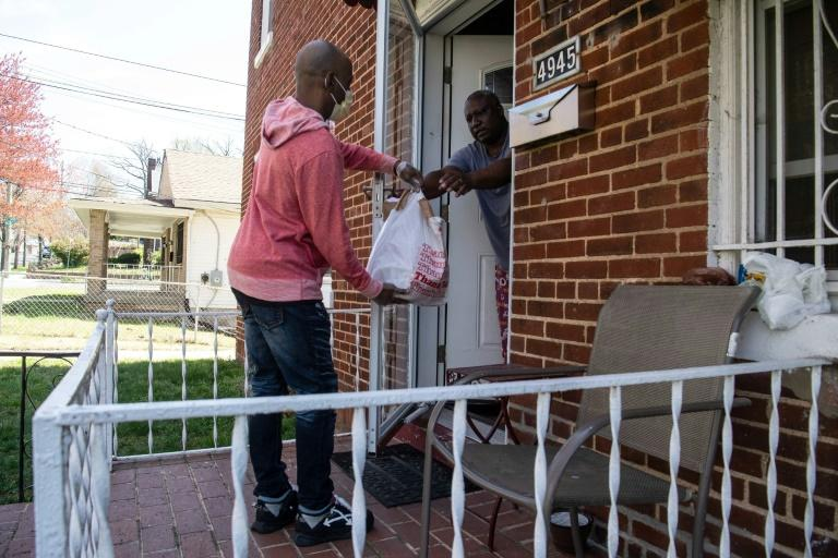 Some Washington city government agencies have referred their clients to the mutual aid network, which can help deliver groceries (as Bernard Stevenson is pictured doing) but is struggling to cope with demand (AFP Photo/NICHOLAS KAMM)