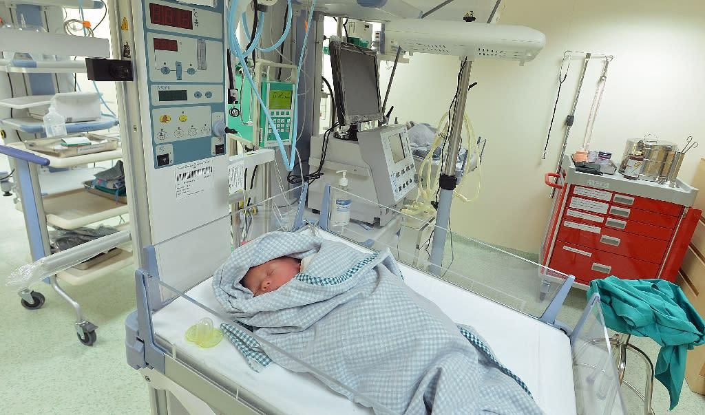 A baby born to a surrogate mother sleeps in a hospital in Kathmandu on May 26, 2015 (AFP Photo/Ishara S.Kodikara)