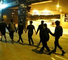 Handful of Hong Kong protesters surrender as university siege nears end