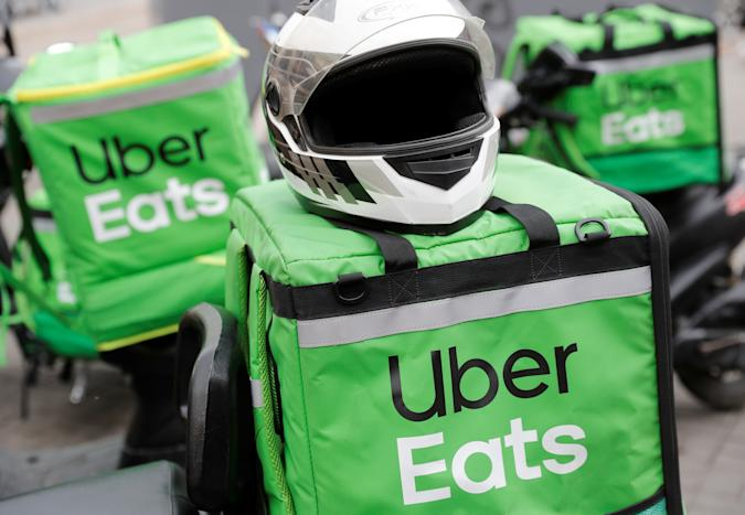 Delivery bags with logos of Uber Eats are seen on a street amid the outbreak of the coronavirus disease (COVID-19) in central Kiev, Ukraine May 27, 2020.  REUTERS/Valentyn Ogirenko