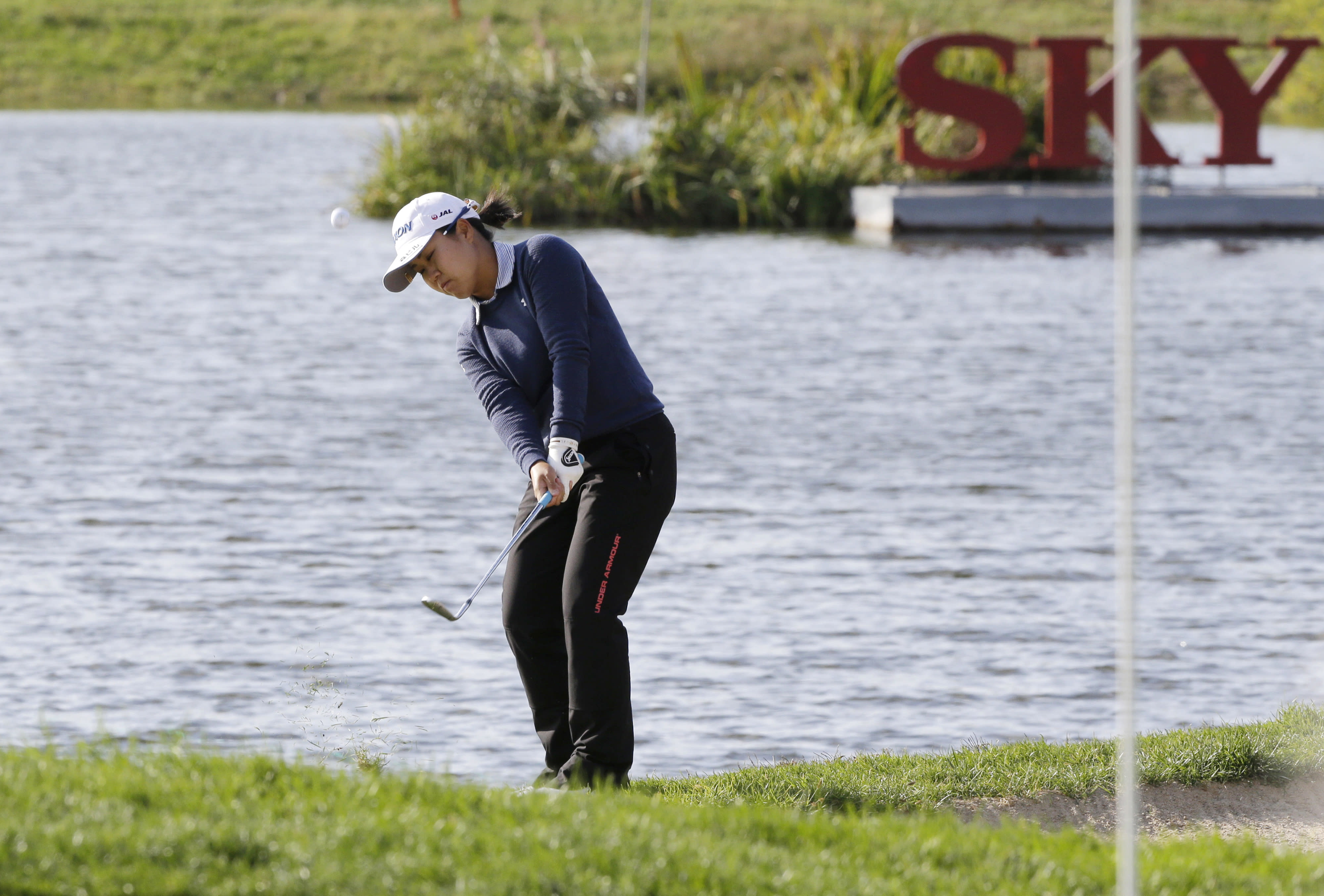 Nasa Hataoka of Japan watches her shot on the 18th hole during the first round of the LPGA KEB Hana Bank Championship at Sky72 Golf Club in Incheon, South Korea, Thursday, Oct. 11, 2018. (AP Photo/Ahn Young-joon)