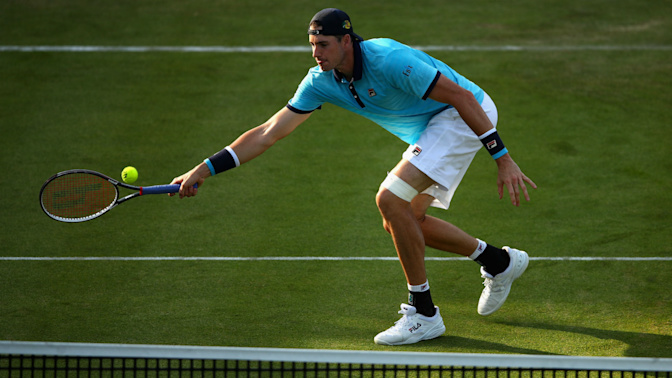 Isner completes Hall of Fame hat-trick