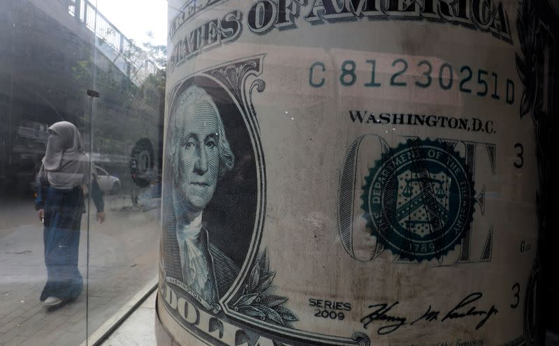 U.S. dollar slides as vaccine news offsets surge in virus cases