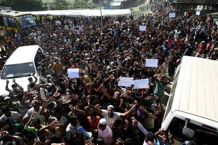 Hundreds of Rohingya refugees shout slogans as they protest against their repatriation at the Unchiprang camp in Teknaf