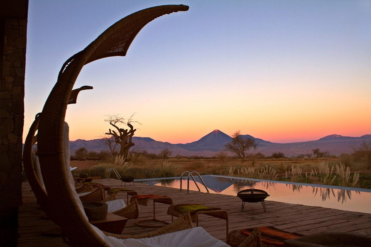 """Could the Atacama Desert, one of the world's most amazing landscapes, provide the perfect setting for your post-nuptials? A honeymoon at <b><a href=""""http://www.tierraatacama.com/"""" target=""""_blank"""">Tierra Tacama</a></b>, an intimate new boutique hotel and spa, includes a room with a view of a volcano, an outdoor shower for bathing under the stars, canopied bed, romantic hot tub dip at sunset with Champagne and chocolate-dipped strawberries, and a free night at the Ritz-Carlton in Santiago. But the real beauty of this lovers' retreat is the location – the Altiplano, which you can explore together on guided hikes, bike and horse rides. From $1,690 per person for a minimum four-night stay."""