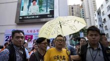 Hong Kong police arrest pro-democracy politician set to run for legislature