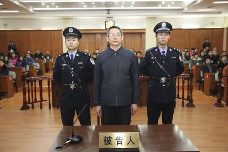 Liu Tienan, the former deputy head of China's top planning agency, stands during his verdict at a court in Langfang, Hebei province