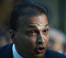 Indian tycoon Ambani pays debt after court threatened jail