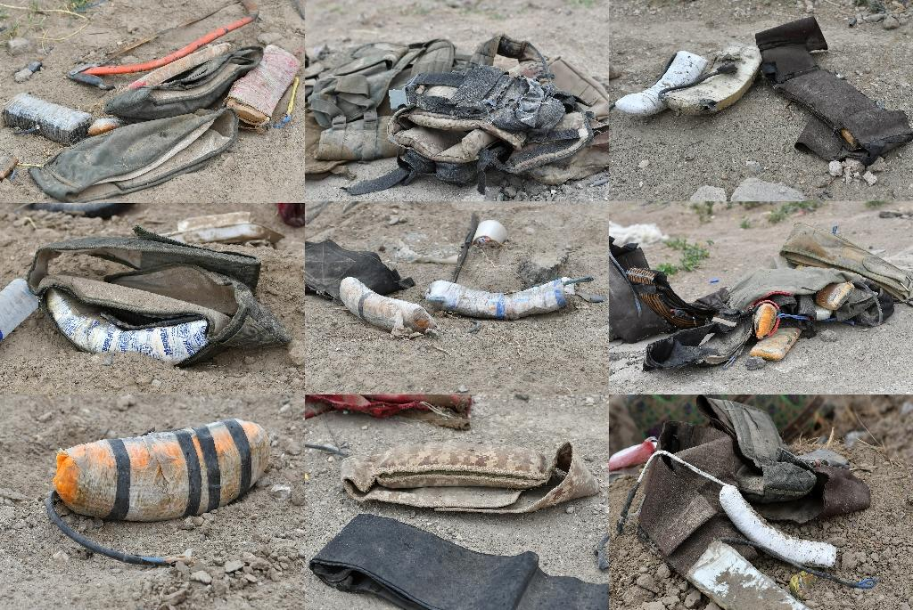 This combination of pictures created on March 24, 2019 shows an assortment of improvised explosive devices and explosive belts lying on the ground in the village of Baghouz in eastern Syria after the defeat of IS jihadists (AFP Photo/GIUSEPPE CACACE)