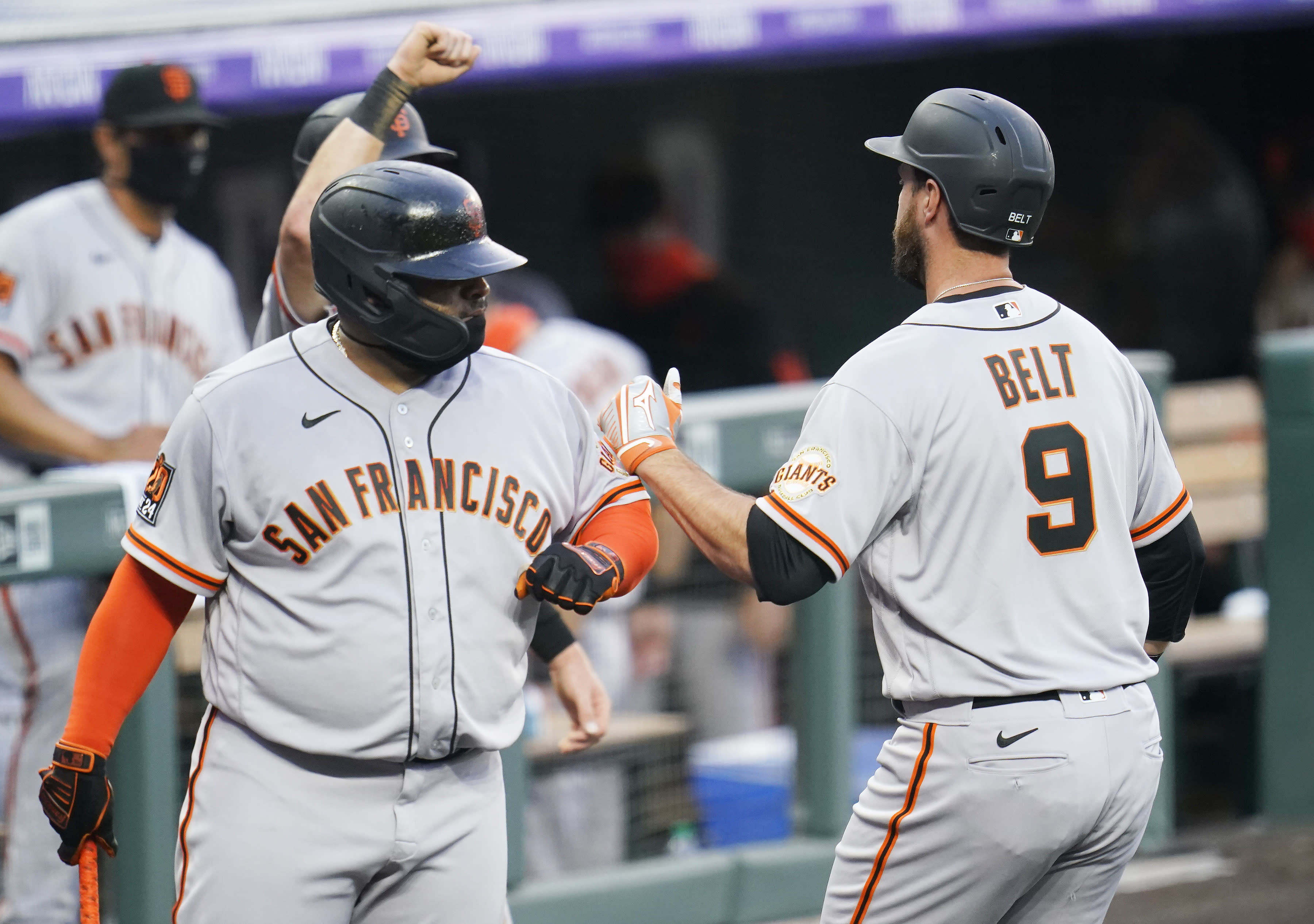 San Francisco Giants' Brandon Belt (9) is congratulated by Pablo Sandoval (48) after hitting a three-run home run against the Colorado Rockies during the fourth inning of a baseball game, Wednesday, Aug. 5, 2020, in Denver. (AP Photo/Jack Dempsey)