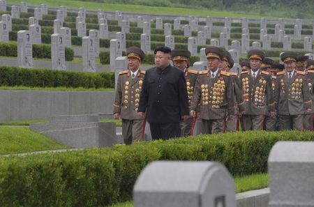 North Korean leader Kim Jong Un visits war graves to pay respect to war dead for the 64th anniversary of the armistice which ended the Korean War, in this undated photo released by KCNA