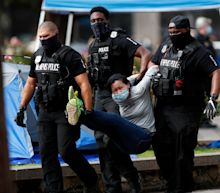 Memphis police clear downtown plaza, detain protesters who camped out for two weeks