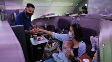 Travel-starved 'passengers' dine on parked Singapore Airlines jet