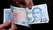 Singapore dollar seen sliding as central bank fights downturn