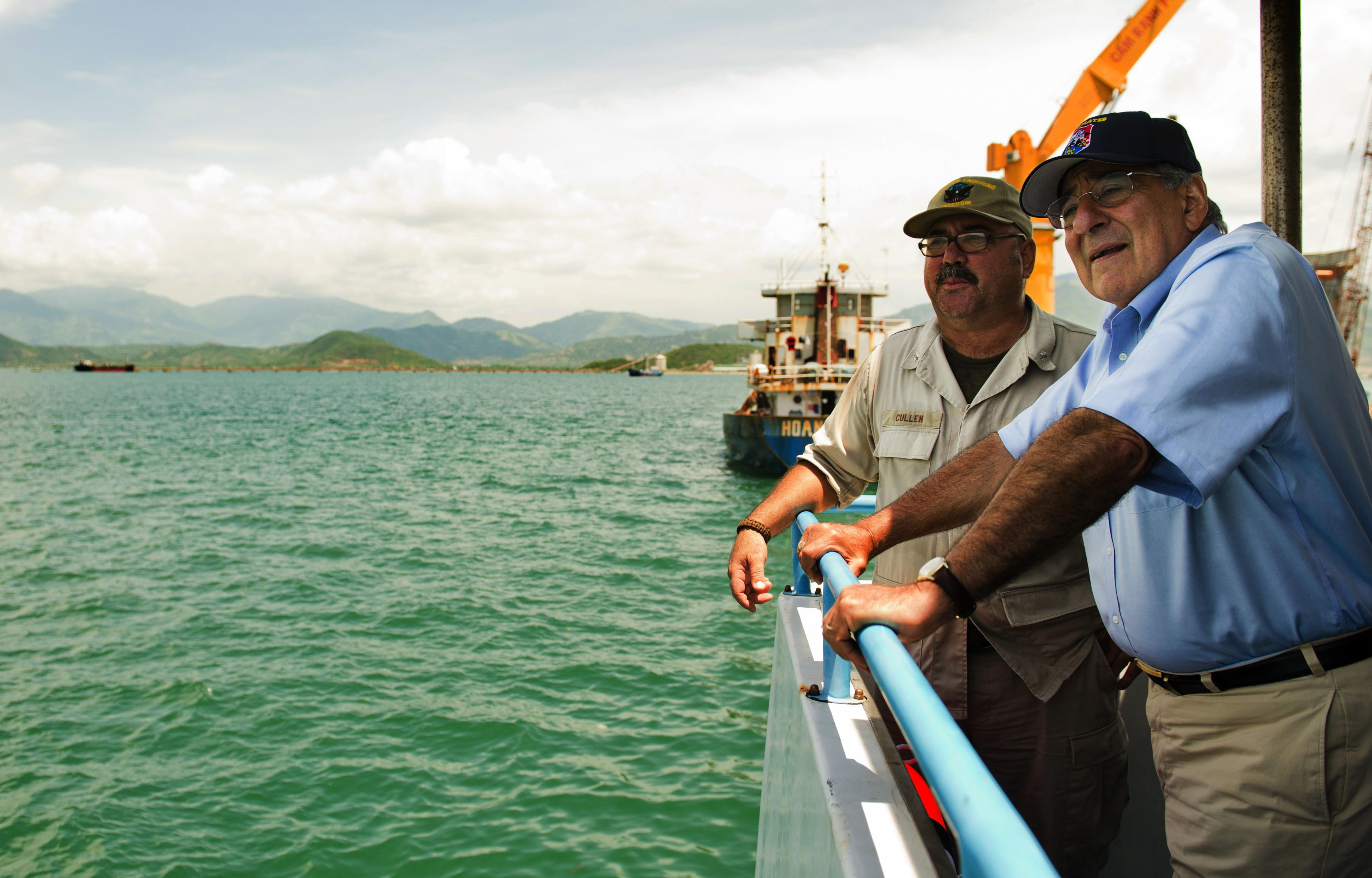 U.S. Secretary of Defense Leon Panetta, right, talks with Chief Mate Fred Cullen as he takes a boat out to a U.S. navy cargo ship USNS Richard E. Byrd in Cam Ranh Bay, Vietnam, Sunday, June 3, 2012. (AP Photo/Jim Watson, Pool)
