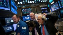 Dow rises 100 points as stocks climb toward record high, helped by dealmaking activity