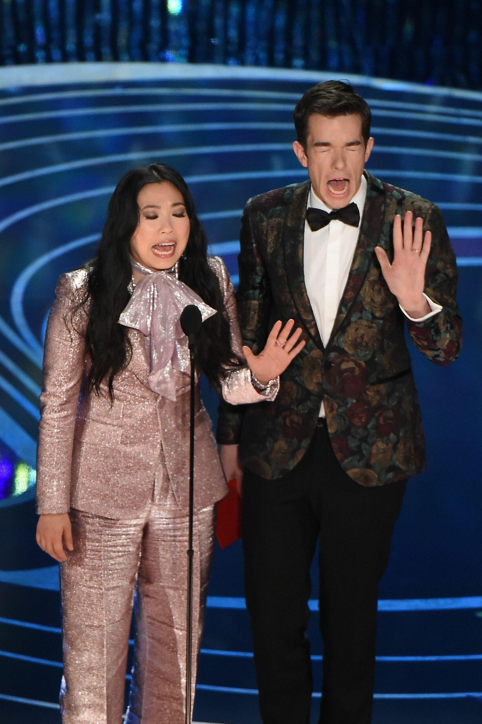 Actress and rapper Awkwafina and John Mullaney present an award during the 91st Annual Academy Awards at the Dolby Theatre in Hollywood, California on February 24, 2019. (Photo by VALERIE MACON / AFP)        (Photo credit should read VALERIE MACON/AFP/Getty Images)