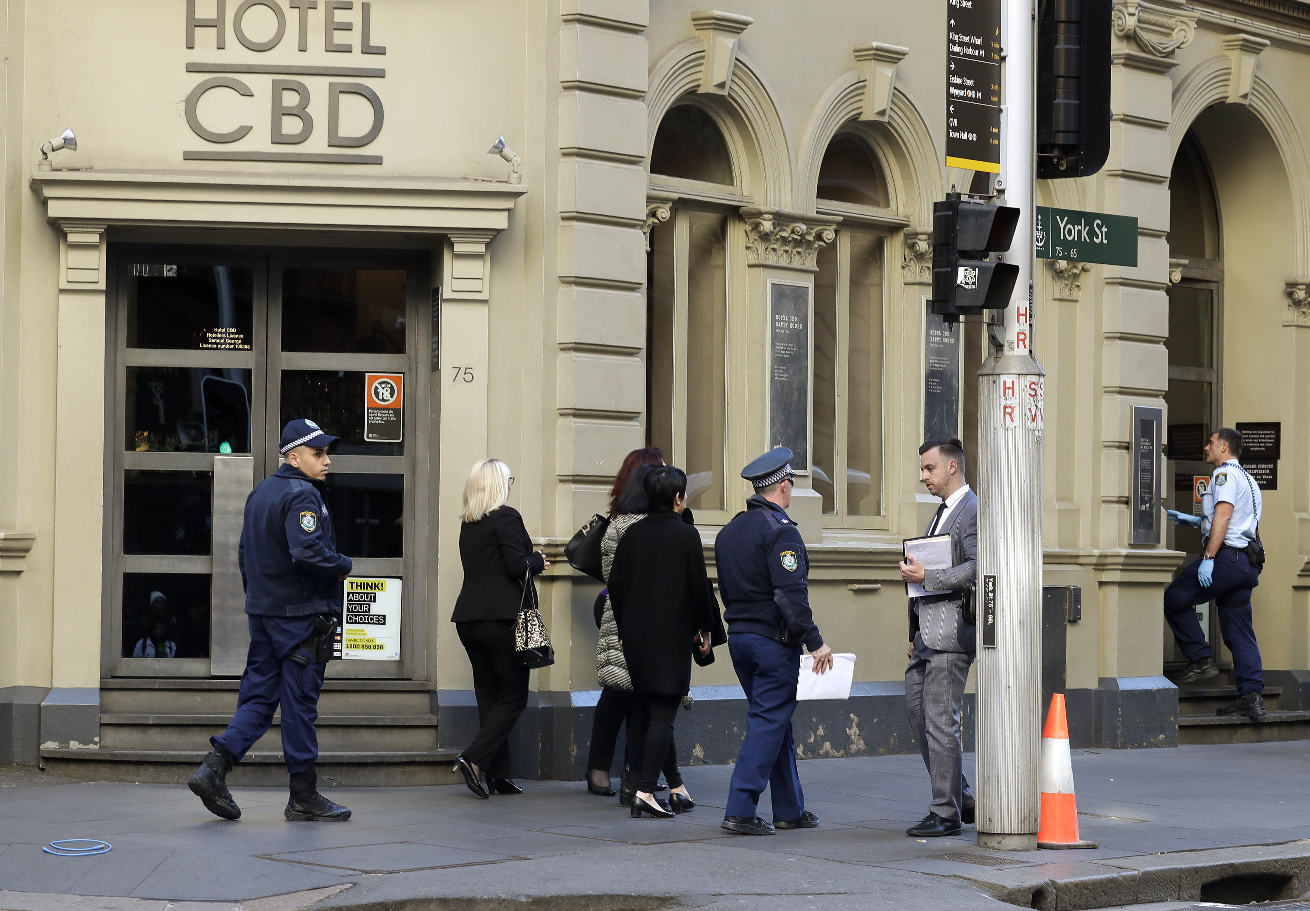 """Police work at a scene where a man attempted to stab multiple people in Sydney, Australia, Tuesday, Aug. 13, 2019. Police and witnesses say a knife-wielding man yelling """"Allahu akbar,"""" or """"God is great,"""" has attempted to stab several people before being arrested, with one person taken to a hospital. (AP Photo/Rick Rycroft)"""