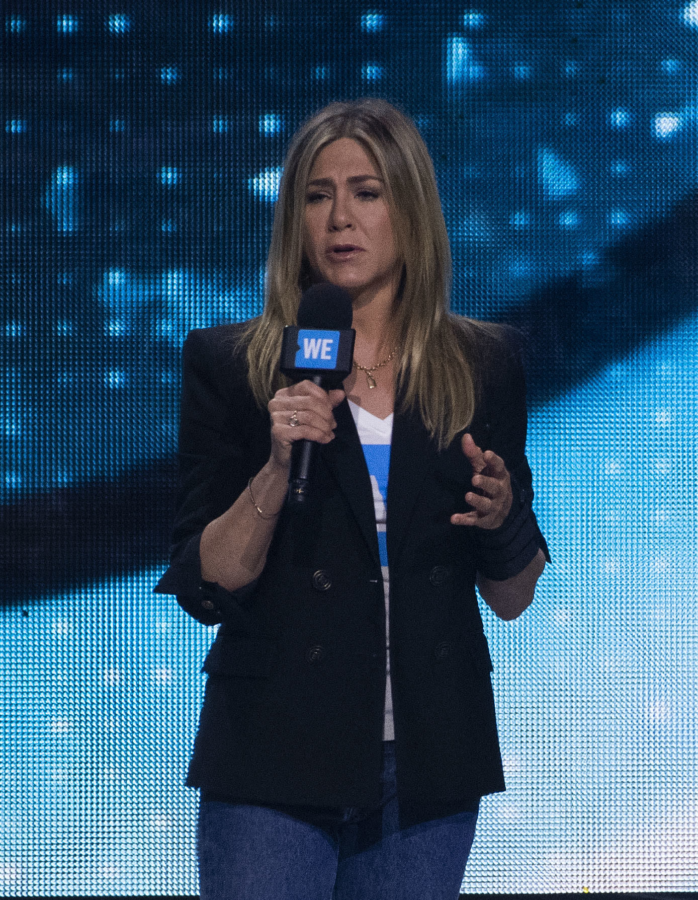 Actress Jennifer Aniston speaks on stage at the WE Day California at The Forum, in Inglewood, California, on April 19, 2018. (Photo by VALERIE MACON / AFP)        (Photo credit should read VALERIE MACON/AFP/Getty Images)