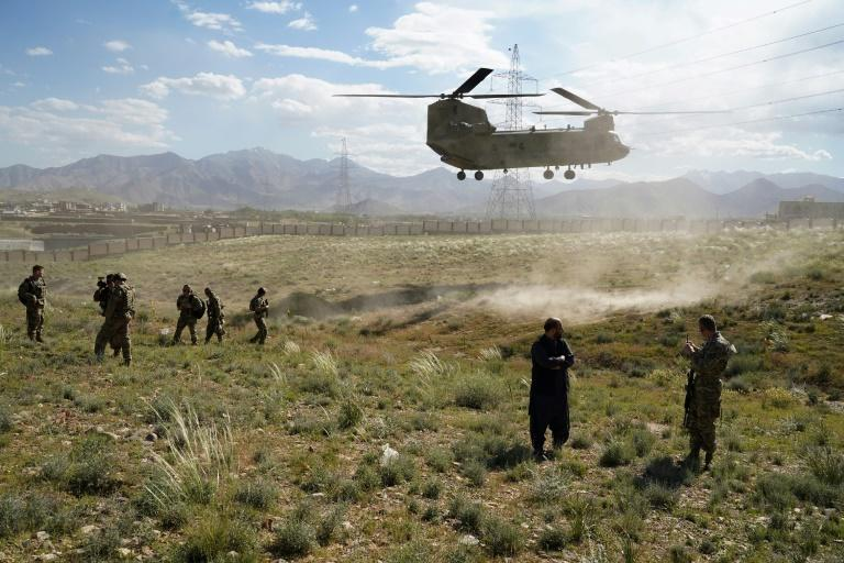A US military Chinook helicopter seen in June 2019 in Afghanistan, where reports say Russia has offered bounties to target US-led forces (AFP Photo/THOMAS WATKINS)
