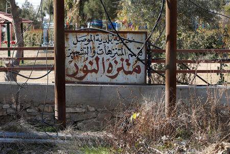 "A sign reads ""Nour Park"" in Arabic at Mosul's zoo, Iraq, February 2, 2017. REUTERS/Muhammad Hamed"