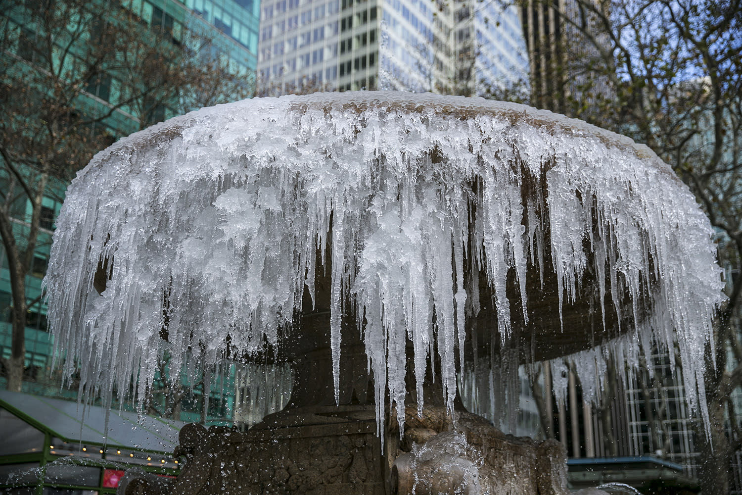 <p>Icicles form on the Josephine Shaw Lowell Fountain in Bryant Park in New York City. Much of the northern Mid-Atlantic and Northeast will stay cold for the next couple of days as the arctic air remains stuck over the northern Appalachians, the National Weather Service said. (Gordon Donovan/Yahoo News) </p>