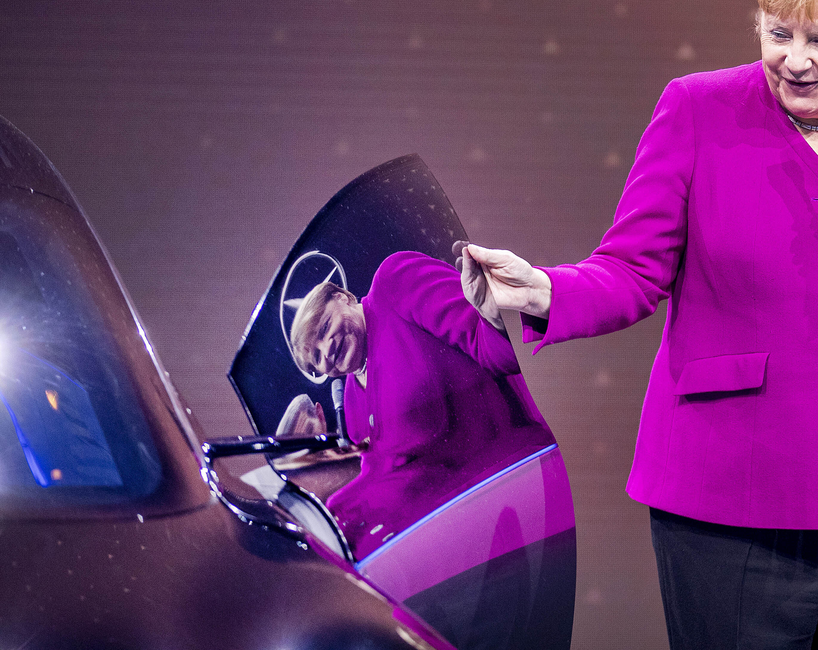 German Chancellor Angela Merkel is reflected in a door of a Mercedes during her visit to the IAA Auto Show in Frankfurt, Germany, Thursday, Sept. 12, 2019. (AP Photo/Michael Probst)