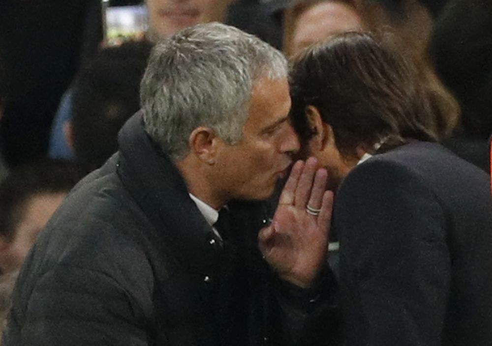 Manchester United manager Jose Mourinho and Chelsea manager Antonio Conte at the end of the match