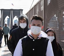WHO says there is no need for healthy people to wear face masks, days after the CDC told all Americans to cover their faces