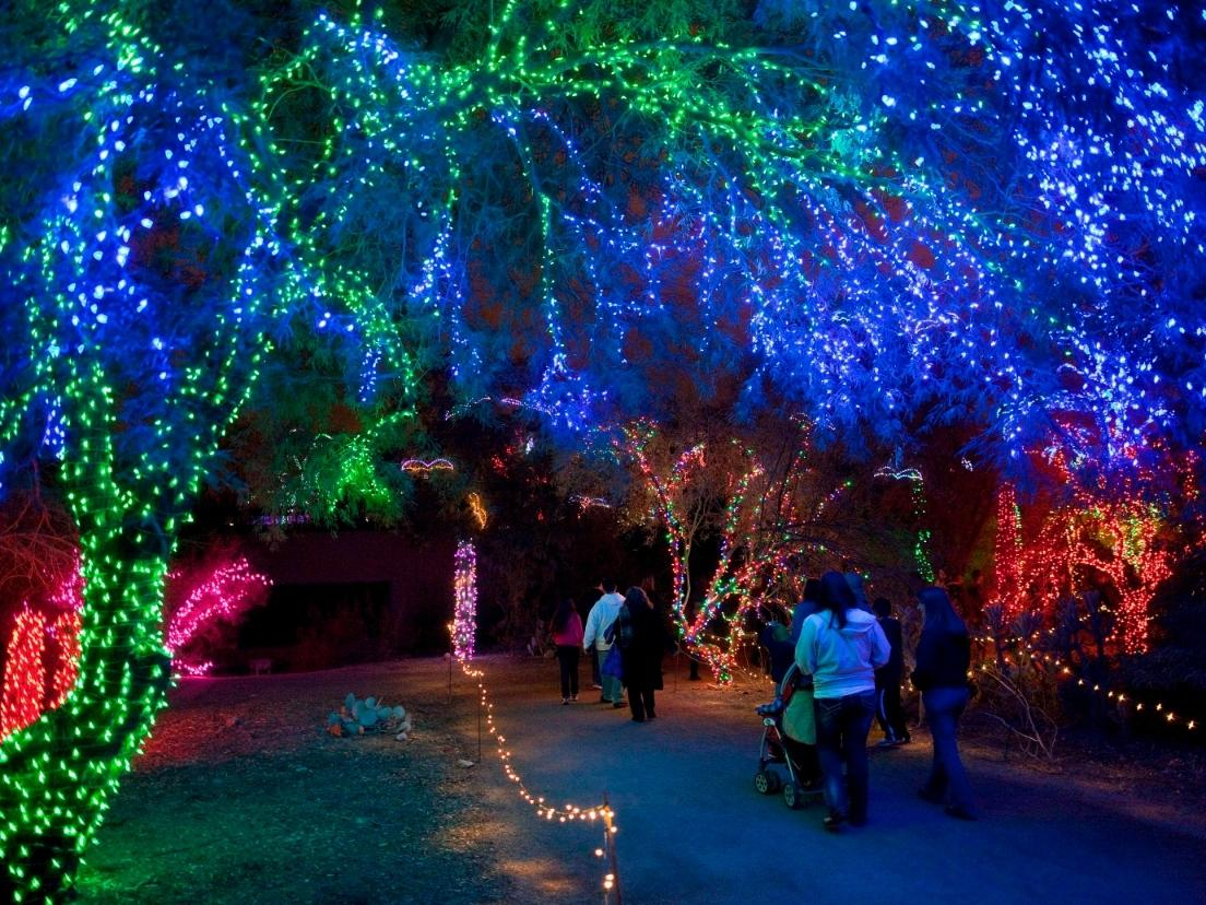 People walk through Phoenix Zoo Wednesday, Dec 21, 2011 while viewing the annual ZooLights display. The 3.5 million-light display is one of the largest holiday light shows in the Southwest and is adjusting in 2020 due to the coronavirus.