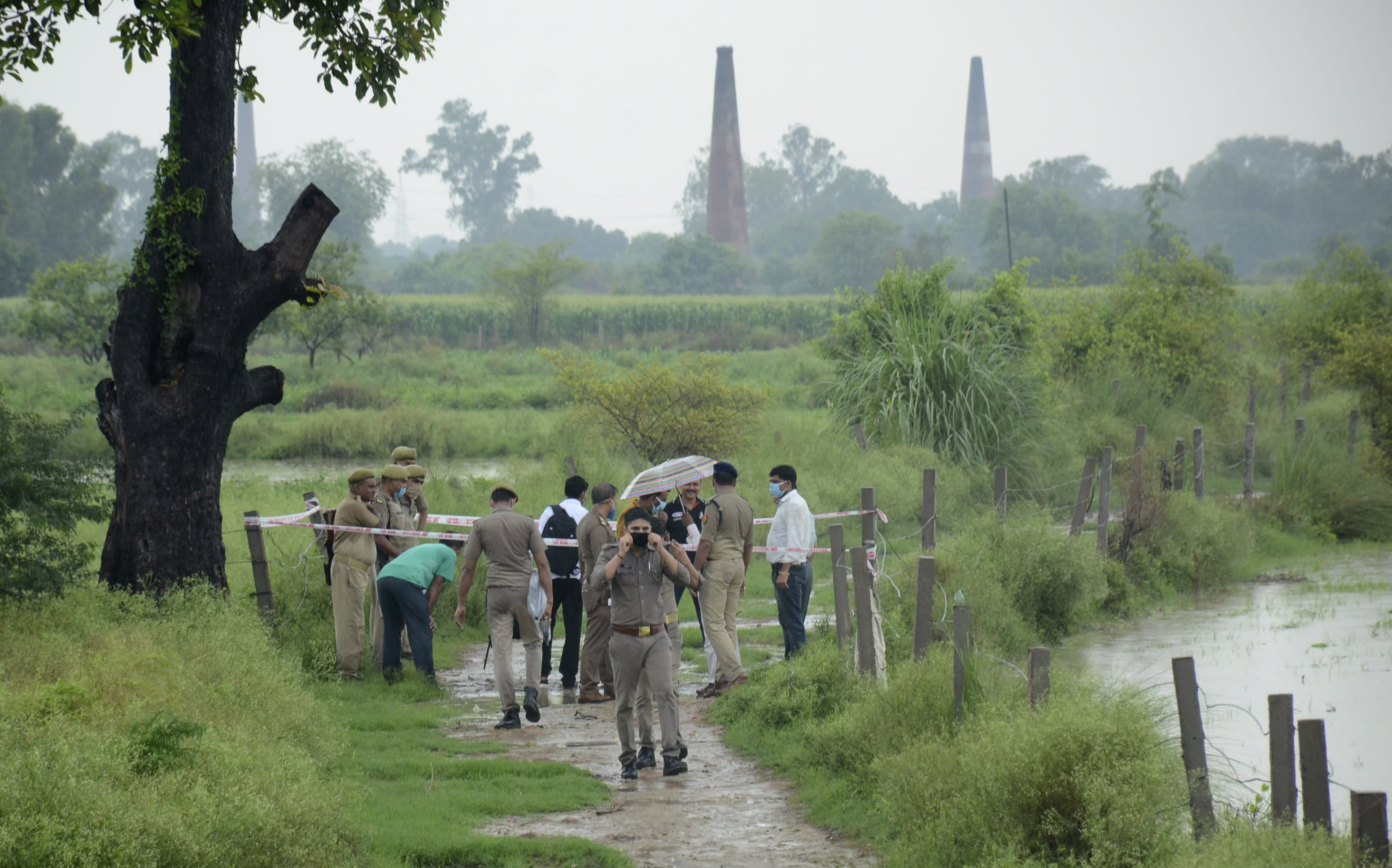 Policemen inspect the site where top criminal Vikas Dubey was killed near Kanpur, India, Friday, July 10, 2020. The top suspect in dozens of crimes, including the killings of eight police officers last week, was fatally shot Friday in police custody while allegedly trying to flee, officials said. Dubey, in his 40s, had given himself up in the central town of Ujjain on Thursday after a weeklong search. A report last month by a New Delhi rights group, the National Campaign Against Torture, said at least 1,731 people died in custody during 2019, which means five custodial deaths a day. (AP Photo)