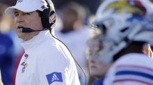 Kansas coach Les Miles cleared to travel after COVID-19 diagnosis but won't go to West Virginia