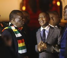 Zimbabwe's president returns amid economic crisis, crackdown