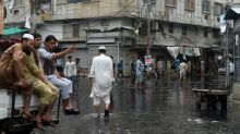Angry residents begin clean up in Karachi as rains lash South Asia