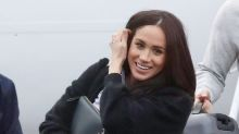 Meghan Markle arrives back to Canada in her favourite $245 'Husband' shirt