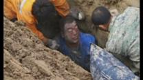 Man buried in sinking earth pit in China