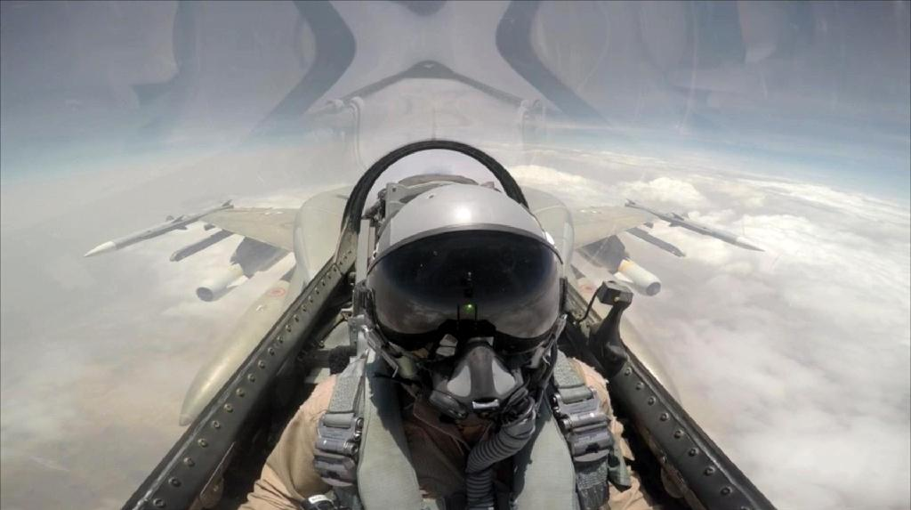 A pilot sits in the cockpit of a United Arab Emirates fighter jet in a photo published by the official WAM news agency in September 2015