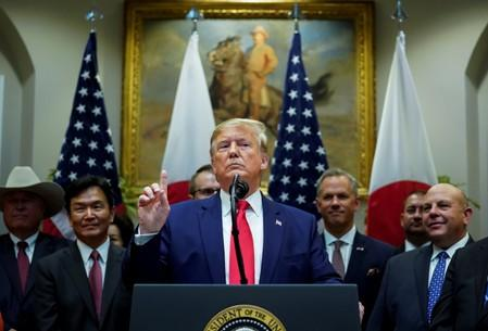 U.S. President Donald Trump speaks about Syria and Turkey during signing ceremony for the U.S.-Japan Trade Agreement at White House in Washington
