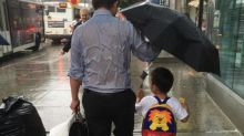 Story Behind Photo of 'Umbrella Dad's' Touching Gesture