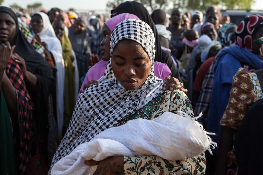 Nigerian women queue to receive humanitarian aid in Yola after fleeing Boko Haram attacks in 2014 (AFP Photo/Florian Plaucheur)