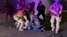 Federal Officers Tackle Protester Holding American Flag in Portland, Oregon