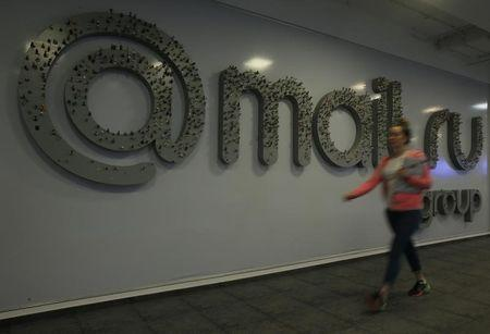 Woman walks past logo of Russian Internet group Mail.ru at its headquarters in Moscow