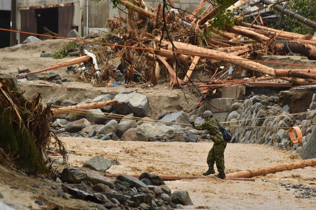 A number of fallen trees were shown smashed into houses in the hard-hit Fukuoka prefecture city of Asakura, which saw more than 50 centimetres (almost 20 inches) of rain in a 12-hour period to Wednesday night. (AFP Photo/KAZUHIRO NOGI)