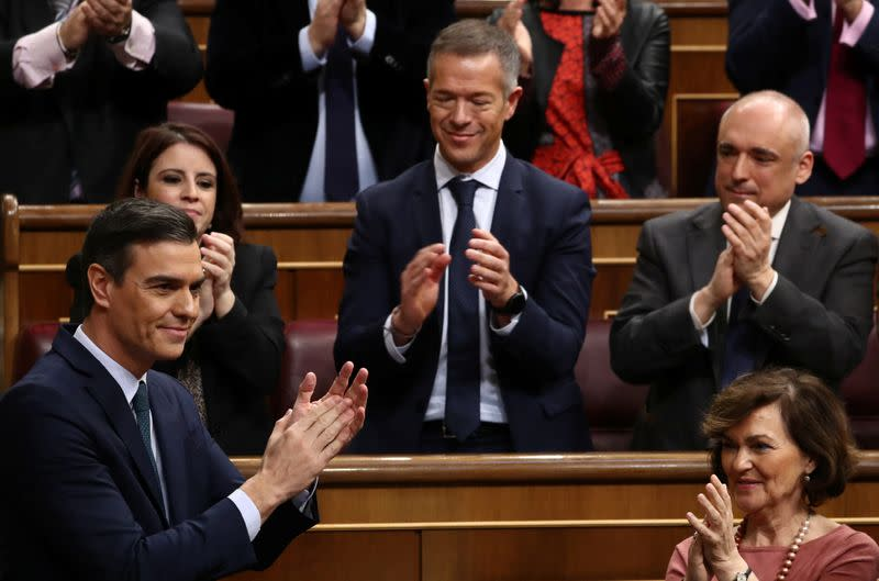 Sanchez sworn in as head of Spain's first coalition govt in decades