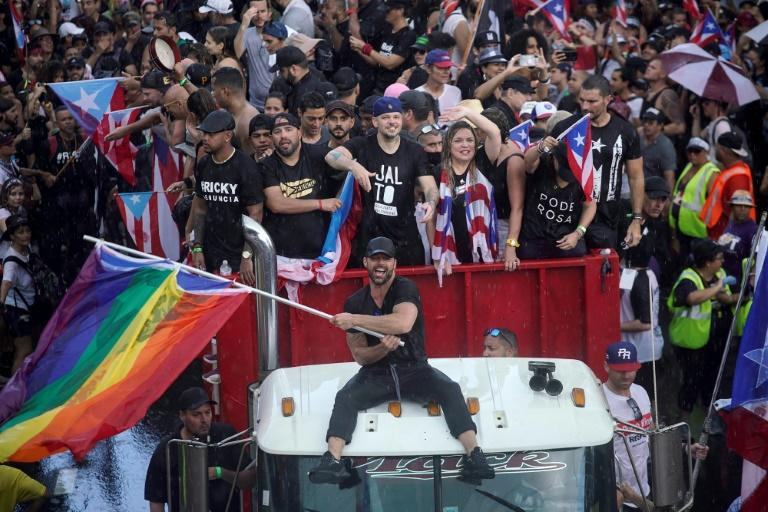 Puerto Rican singer Ricky Martin (C, pictured July 23, 2019), alongside Puerto Rican rapper Rene Perez, aka Residente, became leaders of the protest movement against Rossello (AFP Photo/Eric Rojas)