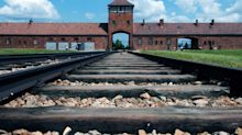 Auschwitz forced to ask visitors not to use railway tracks as 'balance beam'