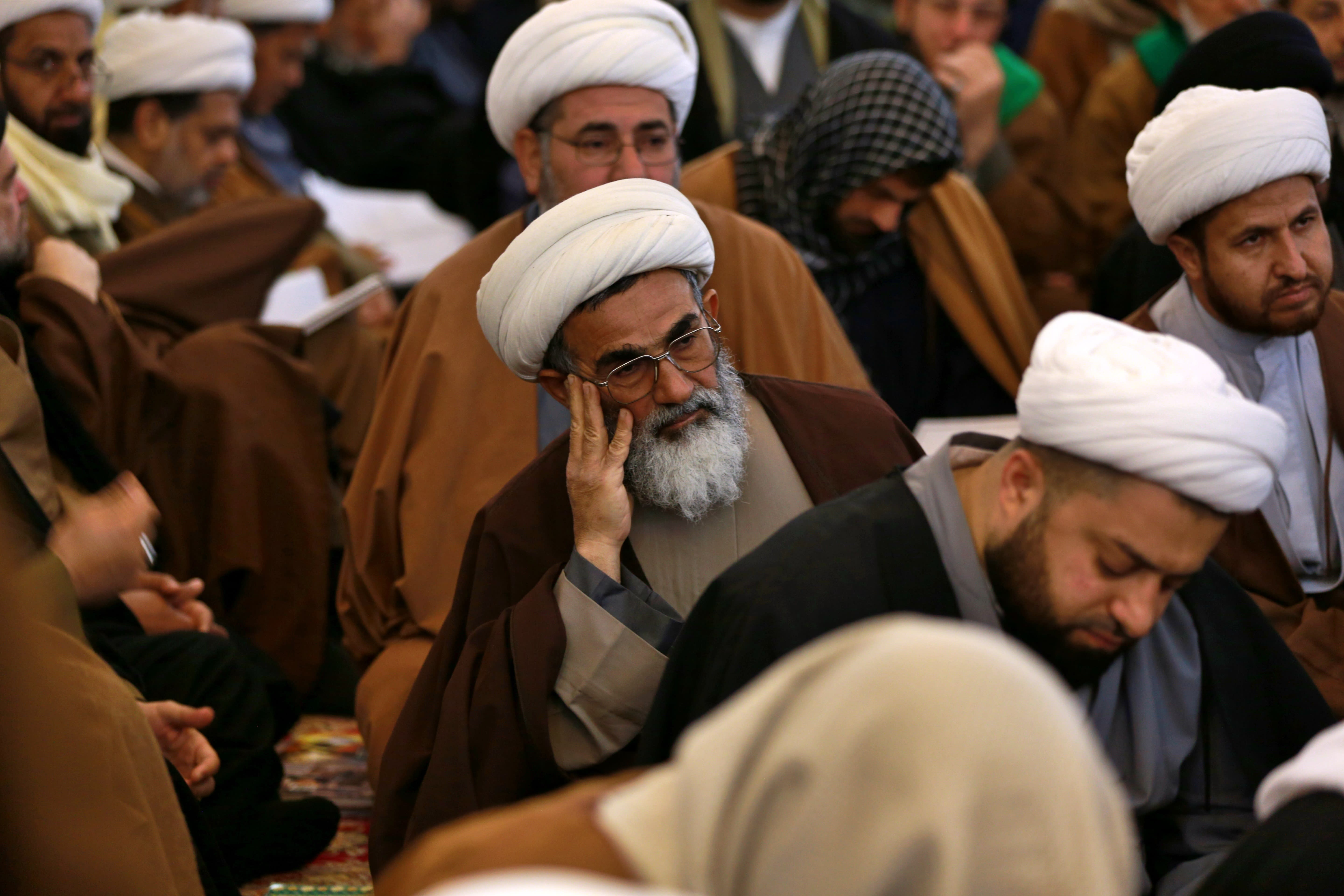 """In this Sunday, Feb. 2, 2020, Shiite seminary students attend a lecture at """"Hawza"""" seminary, in the holy shrine of Imam Ali, the son-in-law, and cousin of the Prophet Muhammad and the first Imam of the Shiites, in Najaf, Iraq. Grand Ayatollah Ali al-Sistani, Iraq's top Shiite cleric, turns 90 this year, and when he recently had surgery it sent chills around the country and beyond. What happens when al-Sistani is gone? Iran is likely to try to exploit the void to gain followers among Iraq's Shiites. Standing in its way is the Hawza, the centuries-old institution of religious learning which al-Sistani heads and which follows its own tradition-bound rules. (AP Photo/Hadi Mizban)"""